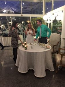 The Bride-and-Groom-to-be take a moment to greet a guest at their Engagement Party in Villa Lombardi's Glass Atrium